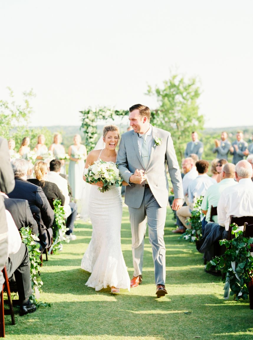 what to know when choosing a wedding photographer - couple walking joyfully back down the aisle