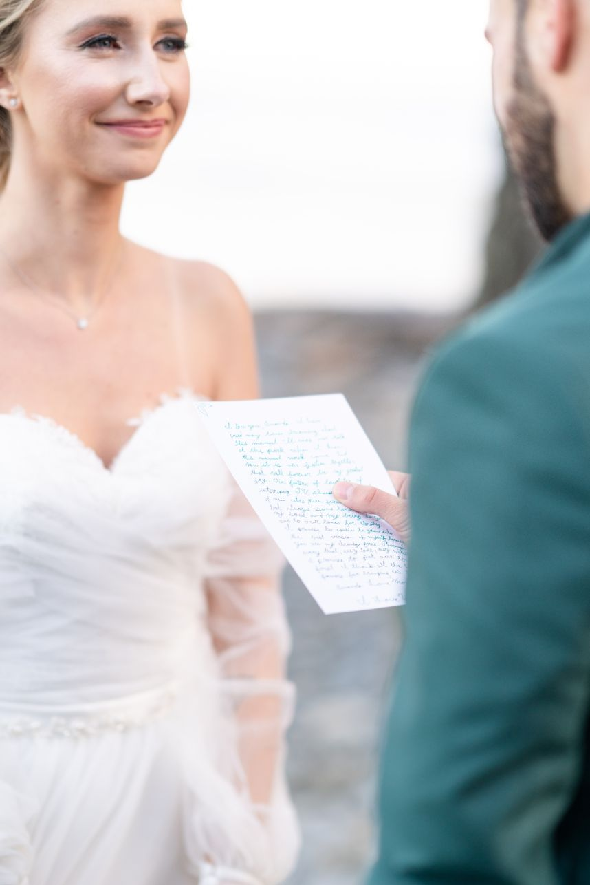 groom reading letter to bride