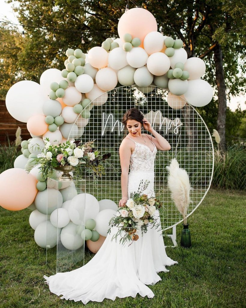 """""""Ultra modern boho chic! Industrial mesh metal backdrops and luxurious custom color balloons are now taking over the bridal industry"""
