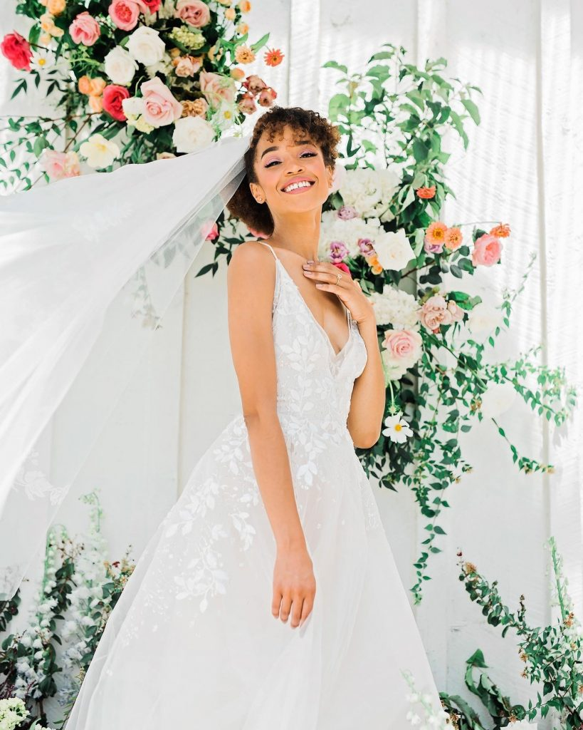 This tiadorabridal ball gown is a DREAM!!! The lace appliqué over the tulle skirt is so romantic and fresh. ?Shop