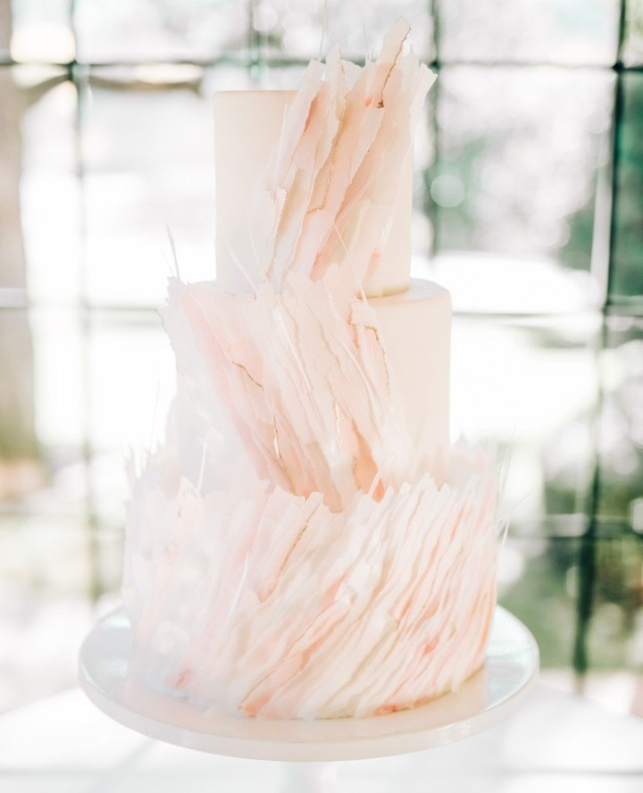 We sure have seen some incredible cakes this year, including these beauties with whimsical, artsy adornments. Catch our recap on