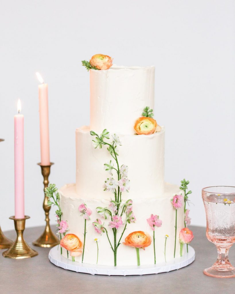"""It's as if there's a garden growing around this cake by sugarbeesweets! """"The cake was a stucco-style whipped textured buttercream"""