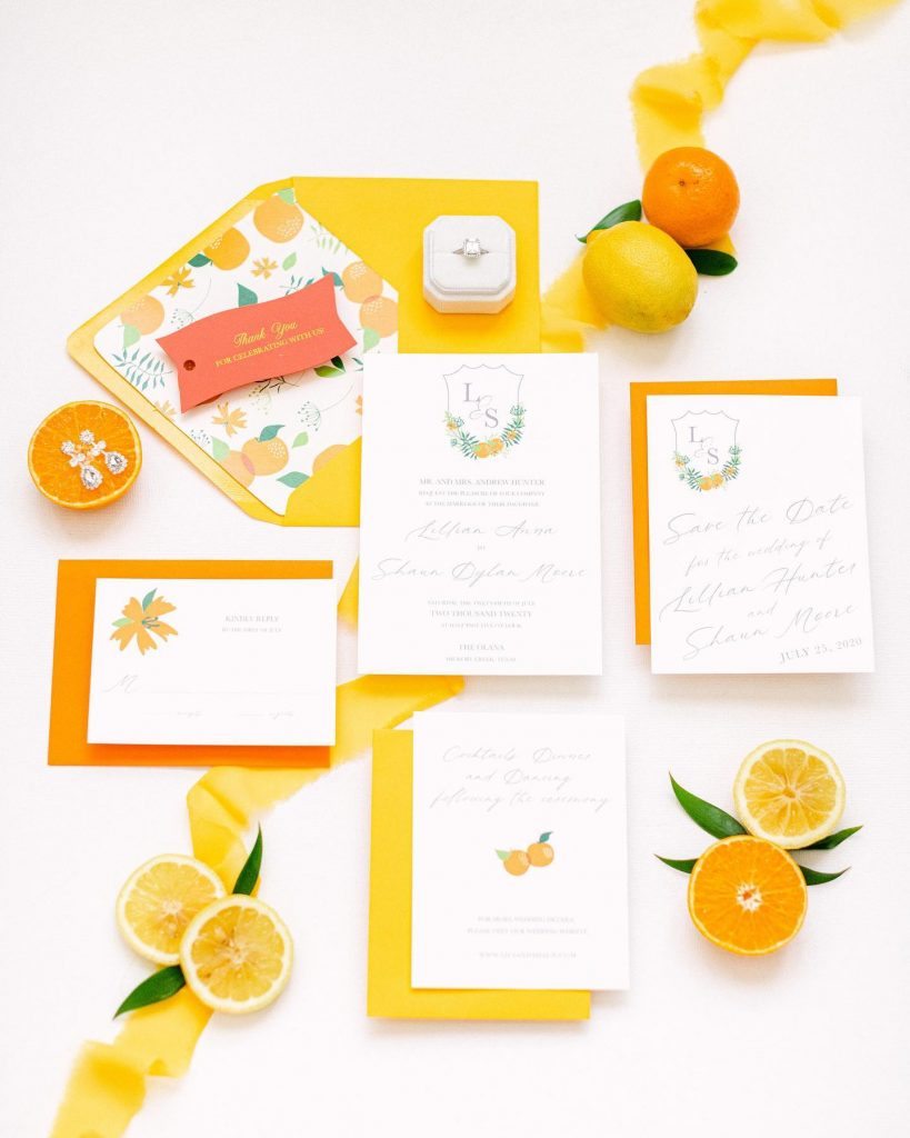 This styled shoot at the iconic theolanatx shows off citrusy, springtime design as well as two brides modeling equally elegant