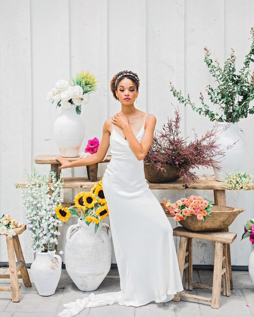 """""""We designed this vignette to feel like a summer flower market, complete with hybrid delphinium, cheery sunflowers, buttery tulips and"""