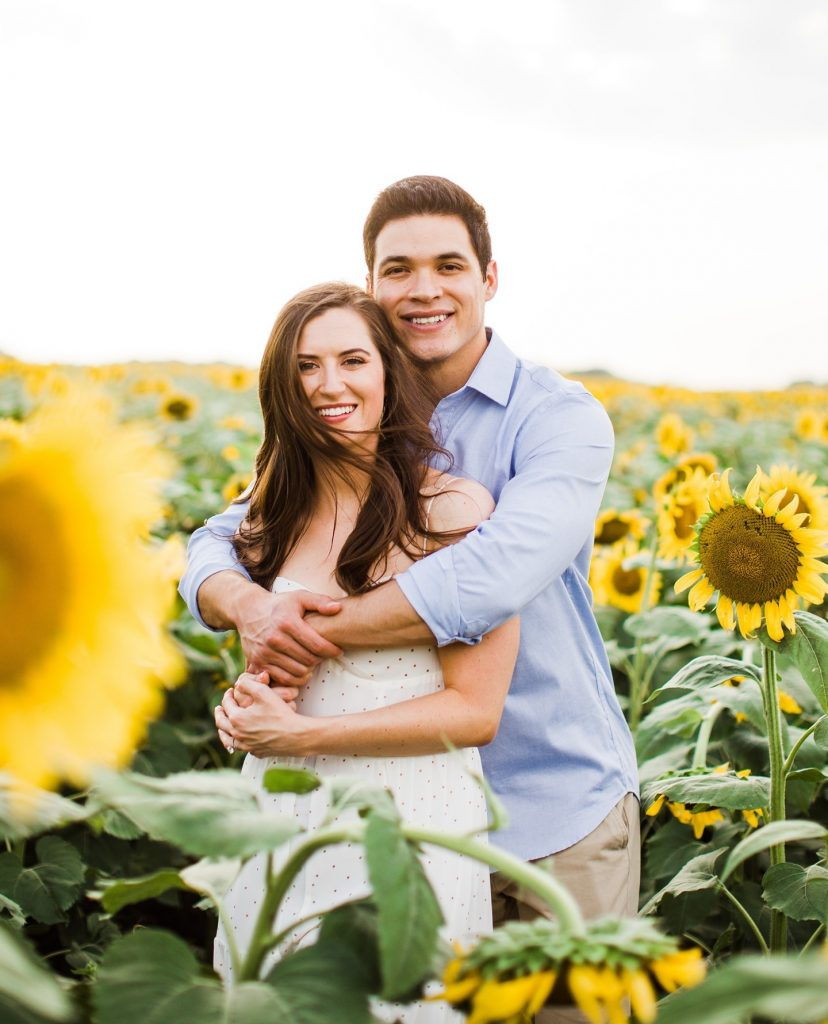 As if we didn't love this sunflower field engagement shoot from sarahblazephotog enough, she told us that this Covid couple