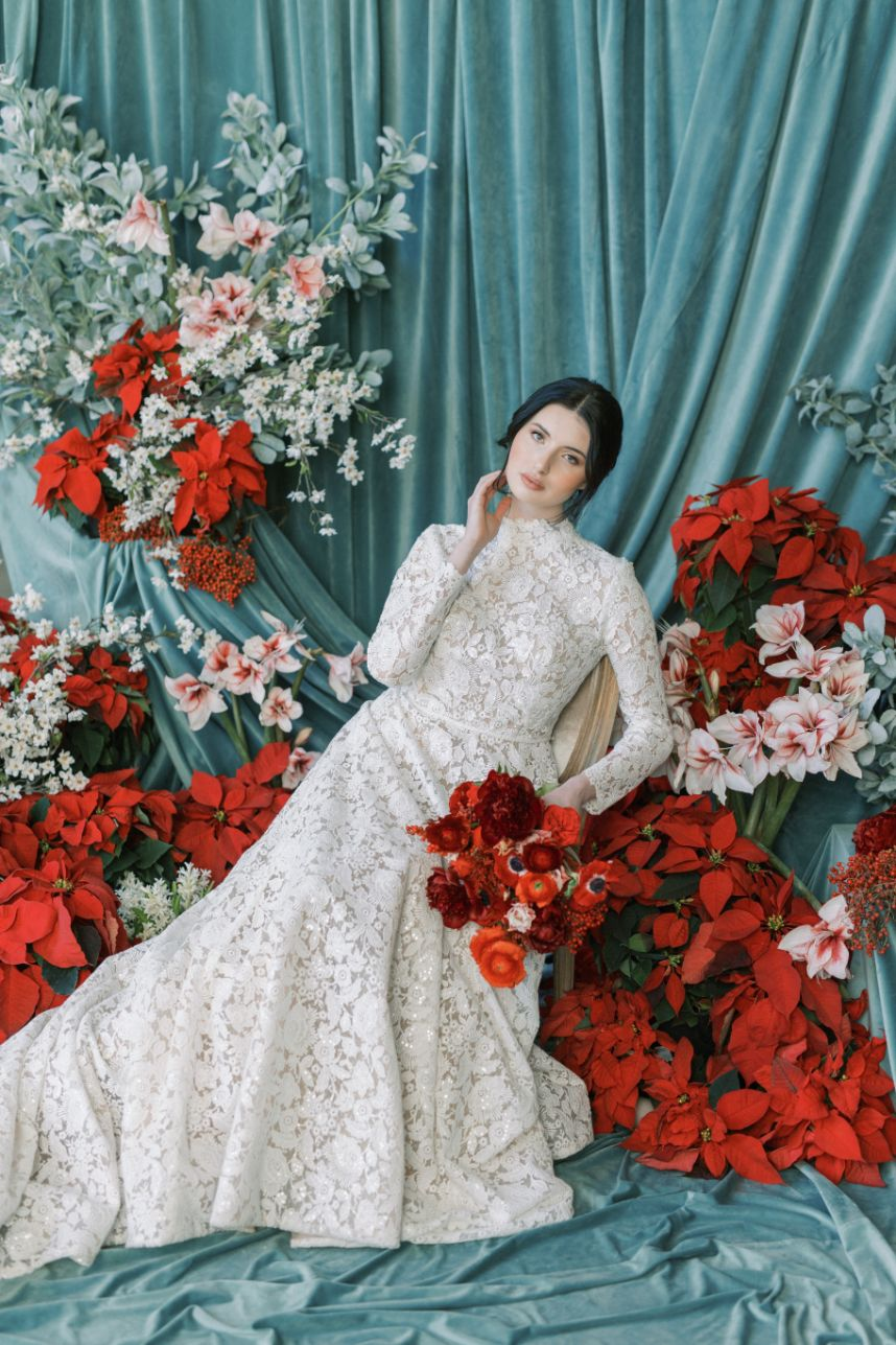 bride surrounded by red flowers