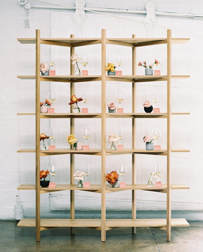 Start your reception off right with a champagne or cocktail wall for guests to quickly grab your fave aperitif on